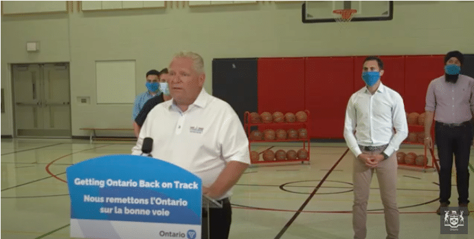 Photo of Ontario Premier Doug Ford, Education Minister Stephen Lecce, Brampton Mayor Patrick Brown, Associate Minister of Small Business and Red Tape Reduction Prabmeet Singh Sarkaria, and Brampton West MPP Amarjot Sandhu at a presser in a school gym.